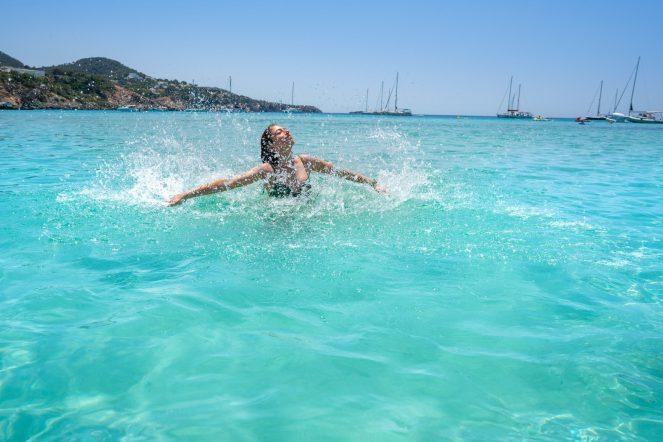 Ibiza,Bikini,Girl,Splashing,Clear,Water,Beach,Of,Balearic,Islands